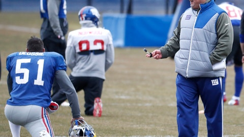 New York Giants head coach Ben McAdoo, right, talks to long snapper Zak DeOssie (51) during NFL football practice, Wednesday, Dec. 28, 2016, in East Rutherford, N.J. (AP Photo/Julio Cortez)