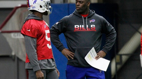 Buffalo Bills quarterback Tyrod Taylor and interim head coach Anthony Lynn talk during a NFL football practice, Wednesday, Dec. 28, 2016, in Orchard Park, N.Y. (AP Photo/Jeffrey T. Barnes)