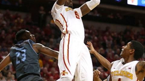 FILE - In a Sunday, Nov. 20, 2016 file photo, Iowa State forward Merrill Holden slams the ball over Citadel guard Kaelon Harris during the first half of an NCAA college basketball game, in Ames, Iowa. Iowa State (8-3) has gotten decent production at times from senior graduate transfers Darrell Bowie (8.5 points, 6.5 rebounds per game) and Holden (4.1 ppg., 2.6 rpg.). But the competition, starting with the Big 12 opener against Texas Tech (11-1), on Dec. 30, is about to get a lot tougher. (AP Photo/Justin Hayworth, File)