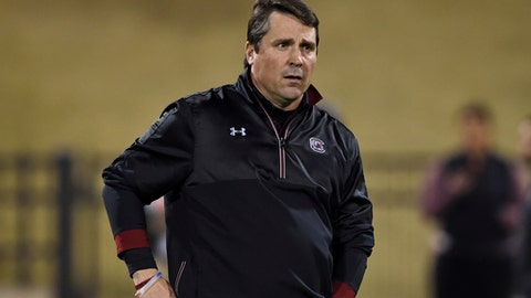 This Nov. 26, 2016 photo shows South Carolina head coach Will Muschamp walking the field before the start of an NCAA college football game against Clemson in Clemson, S.C. South Carolina will face South Florida on Thursday in the Birmingham Bowl. (AP Photo/Richard Shiro)