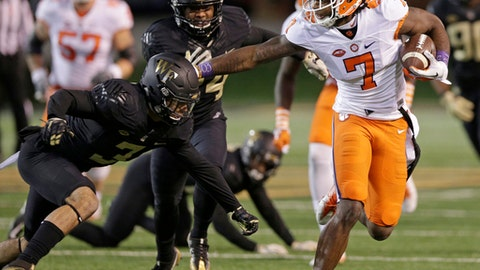 FILE - In a Saturday, Nov. 19, 2016 file photo, Clemson's Mike Williams (7) runs past Wake Forest's Jessie Bates III (3) during the first half of an NCAA college football game in Winston-Salem, N.C. After suffering a broken bone in his neck in 2015 in a collision with a goal post, Williams is back and better than ever. He probably will be the first receiver chosen in the NFL draft. (AP Photo/Chuck Burton, File)