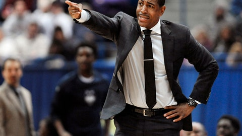 Connecticut head coach Kevin Ollie gestures toward an official in the second half of an NCAA college basketball game against Houston, Wednesday, Dec. 28, 2016, in Hartford, Conn. (AP Photo/Jessica Hill)