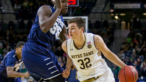 Notre Dame's Steve Vasturia (32) drives around Saint Peter's Quadir Welton (35) during the first half of an NCAA college basketball game Wednesday, Dec. 28, 2016, in South Bend, Ind. (AP Photo/Robert Franklin)