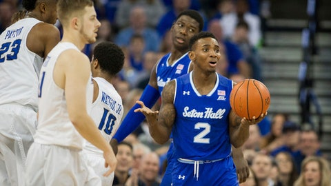 Seton Hall guard Jevon Thomas (2) reacts to being call for traveling during the first half of an NCAA college basketball game against Creighton in Omaha, Neb., Wednesday, Dec. 28, 2016. (AP Photo/John Peterson)
