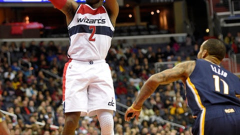 Washington Wizards guard John Wall (2) shoots in front of Indiana Pacers guard Monta Ellis (11) during the second half of an NBA basketball game, Wednesday, Dec. 28, 2016, in Washington. The Wizards won 111-105. (AP Photo/Nick Wass)