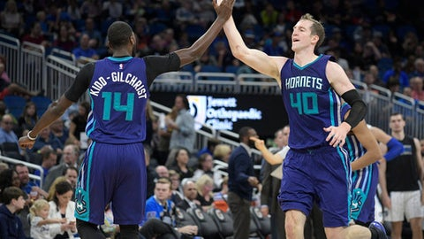 Charlotte Hornets center Cody Zeller (40) is congratulated by forward Michael Kidd-Gilchrist (14) after making a basket during the second half of an NBA basketball game against the Orlando Magic in Orlando, Fla., Wednesday, Dec. 28, 2016. The Hornets won 120-101. (AP Photo/Phelan M. Ebenhack)