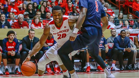 New Mexico's Sam Logwood (20) drives past Fresno State's Jaron Hopkins (1) during the first half of an NCAA college basketball game in Albuquerque, N.M., Wednesday, Dec. 28, 2016. (AP Photo/Juan Antonio Labreche)