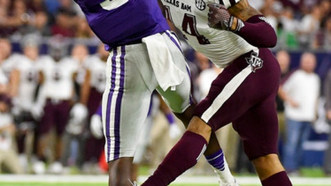 Texas A&M defensive back Justin Evans, right, breaks up a pass intended for Kansas State wide receiver Byron Pringle (9) during the first half of the Texas Bowl NCAA college football game, Wednesday, Dec. 28, 2016, in Houston. (AP Photo/Eric Christian Smith)
