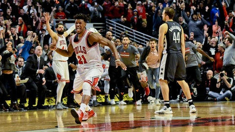 Chicago Bulls forward Jimmy Butler, left, reacts after scoring the game winning basket against the Brooklyn Nets at the end of an NBA basketball game Wednesday, Dec. 28, 2016, in Chicago. Chicago won, 101-99. (AP Photo/Matt Marton)