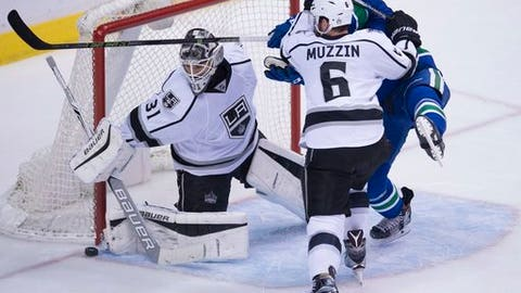 Los Angeles Kings defenseman Jake Muzzin (6) tries to clear Vancouver Canucks right wing Jack Skille (9) from in front of Kings goalie Peter Budaj (31) during the third period of an NHL hockey game Wednesday, Dec. 28, 2016, in Vancouver, British Columbia. (Jonathan Hayward/The Canadian Press via AP)