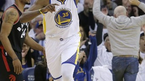 Golden State Warriors forward Kevin Durant (35) celebrates after scoring as Toronto Raptors guard Norman Powell (24) walks nearby during the first half of an NBA basketball game in Oakland, Calif., Wednesday, Dec. 28, 2016. (AP Photo/Jeff Chiu)