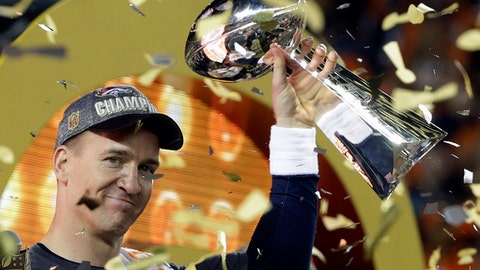 FILE - In this Feb. 7, 2016, file photo, Denver Broncos quarterback Peyton Manning holds up the Vince Lombardi Trophy after the Broncos defeated the Carolina Panthers 24-10 in NFL football's Super Bowl 50 in Santa Clara, Calif. Manning announced his retirement from professional football on Marc 7, 2016. (AP Photo/Julie Jacobson, File)