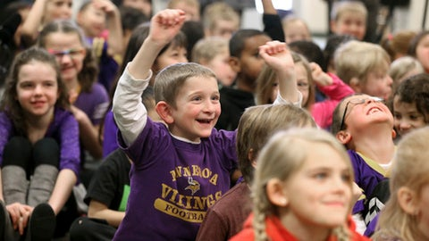 FILE - In this Jan. 14, 2016 file photo, first grader Cody Rudoy smiles with excitement as Minnesota Vikings kicker Blair Walsh thanks first graders at Northpoint Elementary School for writing letters of encouragement to him after he missed a 27-yard field goal in an NFL wild-card football game against the Seattle Seahawks, in Blaine, Minn.  (Jerry Holt/Star Tribune via AP, File)