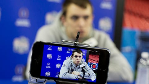 Washington quarterback Jake Browning is recorded on a reporter's phone answering a question during media day for Saturday's Peach Bowl NCAA college football game against Alabama in Atlanta, Thursday, Dec. 29, 2016. (AP Photo/David Goldman)
