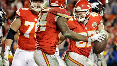 FILE - In a Dec. 25, 2016 file photo, Kansas City Chiefs tight end Travis Kelce, right, celebrates with tight end Demetrius Harris (84), after Harris caught a touchdown pass against the Denver Broncos during the second half of an NFL football game in Kansas City, Mo. The beginning of the end for the defending champions Broncos came in Week 12 in a frigid classic.  The Broncos blew an eight-point lead over Kansas City and lost 30-27 when Cairo Santos banked a field goal as overtime expired.  (AP Photo/Charlie Riedel, File)