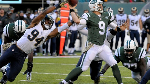 FILE - In a Sunday, Nov. 13, 2016 file photo, New York Jets quarterback Bryce Petty (9) throws under pressure from Los Angeles Rams defensive end Robert Quinn (94) during the third quarter of an NFL football game, in East Rutherford, N.J. Los Angeles won this snoozer without scoring any touchdowns, needing just Greg Zuerlein's three field goals to beat New York 9-6.  (AP Photo/Bill Kostroun, File)