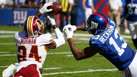 FILE - In this Sept. 25, 2016, file photo, Washington Redskins cornerback Josh Norman (24) fights for control of the ball with New York Giants' Odell Beckham Jr. (13) during the first half of an NFL football game in East Rutherford, N.J. In the final Sunday of the schedule, look for the Giants to play hard and with the starters against up-and-down Washington. (AP Photo/Kathy Willens, File)