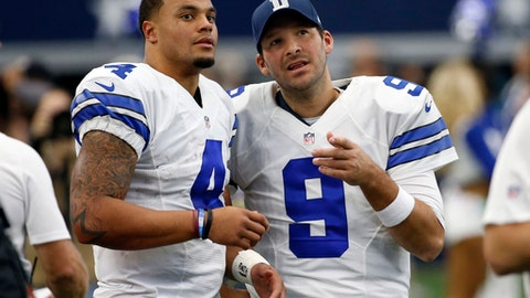 FILE - In a Sunday, Nov. 20, 2016 file photo, Dallas Cowboys' Dak Prescott (4) and Tony Romo (9) talk on the sideline in the first half of an NFL football game against the Baltimore Ravens in Arlington, Texas. The Cowboys went on a record-setting run without quarterback Romo, thanks to a pair of star rookies, Dak Prescott and Esekiel Elliott. (AP Photo/Michael Ainsworth, File)
