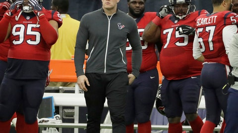 FILE - In a Sunday, Dec. 18, 2016 file photo, Houston Texans defensive end J.J. Watt watches from the sideline for the first time since his season-ending back injury during the first half of an NFL football game against the Jacksonville Jaguars, in Houston. Watt missed all but three games with a back injury that required surgery. But 2014 top overall pick Jadeveon Clowney moved from outside linebacker to help account for the loss, and the Texans are headed to the playoffs for the second consecutive season. (AP Photo/Eric Christian Smith, File)