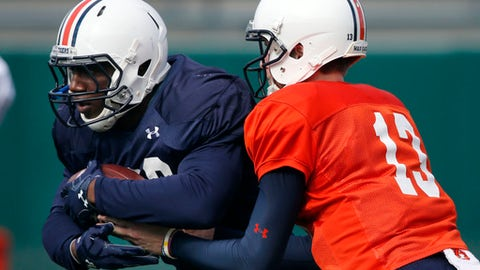 Auburn quarterback Sean White (13) hands off to running back Kamryn Pettway during practice in New Orleans, Thursday, Dec. 29, 2016, for the Sugar Bowl NCAA college football game, which will be played Jan. 2, 2017 against Oklahoma. (AP Photo/Gerald Herbert)