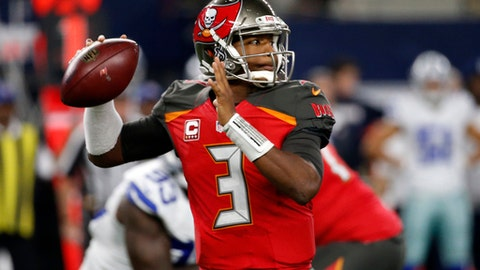 FILE - In a Sunday, Dec. 18, 2016 file photo, Tampa Bay Buccaneers quarterback Jameis Winston (3) throws a pass in the first half of an NFL football game against the Dallas Cowboys, in Arlington, Texas. A win on Jan. 1 gives the Bucs (8-7) their first winning season in six years. That plus, six other results going Tampa Bay's way on Sunday, would send them into the playoffs for the first time since 2007.  (AP Photo/Michael Ainsworth, File)