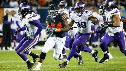 FILE - In a Monday, Oct. 31, 2016 file photo, Chicago Bears running back Jordan Howard (24) runs from Minnesota Vikings strong safety Anthony Harris, from left, Danielle Hunter (99) and Eric Kendricks (54) during the first half of an NFL football game in Chicago. The most condemning development of this 2-8 stretch the Vikings have endured since their bye week has been the lapses by a defense that has otherwise been one of the NFL's best. Allowing 202 yards from scrimmage to Howard in that 20-10 defeat by the Bears was one of those low points. (AP Photo/Nam Y. Huh, File)