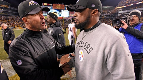 FILE - In a Sunday, Dec. 25, 2016 file photo, Pittsburgh Steelers head coach Mike Tomlin, right, and Baltimore Ravens head coach John Harbaugh meet following an NFL football game in Pittsburgh. The Ravens were mere seconds away from taking control of the AFC North when the Steelers snatched it away from them, scoring a touchdown with 9 seconds left for a 31-27 win that ended Baltimore's chances last week. The Ravens (8-7) and Bengals (5-9-1) will be starting a new year together on Jan. 1. It's the sixth time in the past seven seasons that the AFC North rivals Ravens and Bengals have finished the regular season against each other.(AP Photo/Don Wright, File)