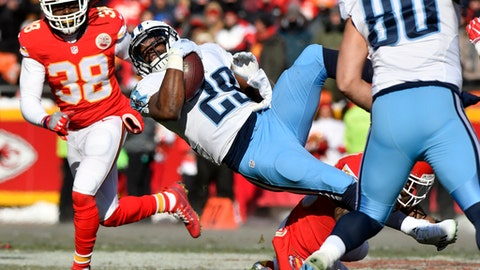 FILE - In a Sunday, Dec. 18, 2016 file photo, Tennessee Titans running back DeMarco Murray (29) is tackled by Kansas City Chiefs defensive back Steven Nelson, right rear, during the first half of an NFL football game in Kansas City, Mo. Murray has a chance to lead the AFC in rushing with a strong performance Sunday, Jan. 1 in Tennessee's season finale. (AP Photo/Ed Zurga, File)