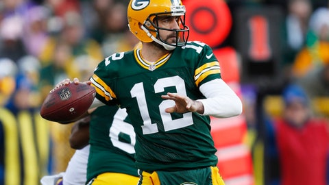 FILE - In this Saturday, Dec. 24, 2016 file photo, Green Bay Packers' Aaron Rodgers throws during the first half of an NFL football game against the Minnesota Vikings in Green Bay, Wis. (AP Photo/Matt Ludtke, File)