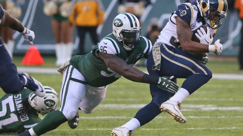 "FILE - In this Nov. 13, 2016, file photo, Los Angeles Rams running back Todd Gurley (30) is tackled by New York Jets defensive end Muhammad Wilkerson (96) during an NFL football game in East Rutherford, N.J. Wilkerson knew something wasn't quite right with his ankle early in the season. The defensive end wasn't his usual playmaking self, unable to move around the field the way he has for most of his career. ""It sounds like an excuse,"" Wilkerson said Thursday, Dec. 29. ""It's just football. It's part of the game. It's something I learned from."" (AP Photo/Seth Wenig, File)"