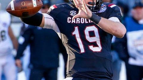 South Carolina quarterback Jake Bentley (19) throws a pass against South Florida during the second half of the Birmingham Bowl NCAA college football game, Thursday, Dec. 29, 2016, in Birmingham, Ala. (AP Photo/Butch Dill)