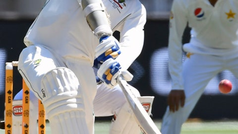 Australia's Mitchell Starc hits a six against the bowling of Pakistan's Azhar Ali on the fifth day of their second cricket test in Melbourne, Australia, Friday, Dec. 30, 2016. (AP Photo/Andy Brownbill)