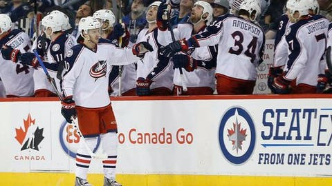 Columbus Blue Jackets' Alexander Wennberg (10) celebrates his goal against the Winnipeg Jets during the second period of an NHL hockey game Thursday, Dec. 29, 2016, in Winnipeg, Manitoba. (John Woods/The Canadian Press via AP)