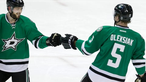 Dallas Stars center Tyler Seguin, left, congratulates teammate Jamie Oleksiak (5) after Oleksiak scored a goal during the second period of an NHL hockey game against the Colorado Avalanche in Dallas, Thursday, Dec. 29, 2016. (AP Photo/LM Otero)