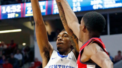 Kentucky guard Malik Monk (5) shoots a jumper past a Mississippi defender in the first half of the NCAA college basketball game in Oxford, Miss., Thursday, Dec. 29, 2016. No. 8 Kentucky won 99-76. (AP Photo/Rogelio V. Solis)