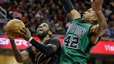 Cleveland Cavaliers' Kyrie Irving, left, drives to the basket against Boston Celtics' Al Horford, from the Dominican Republic, in the second half of an NBA basketball game, Thursday, Dec. 29, 2016, in Cleveland. (AP Photo/Tony Dejak)