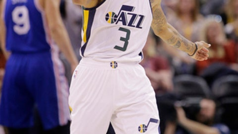 Utah Jazz guard George Hill (3) celebrates as he runs up court in the first half during an NBA basketball game against the Philadelphia 76ers Thursday, Dec. 29, 2016, in Salt Lake City. (AP Photo/Rick Bowmer)