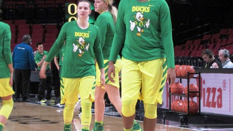 In this Dec. 17, 2016, photo, Oregon forward Ruthy Hebard practices with the team before an NCAA college basketball game against Portland State in Portland, Ore. The freshman forward grew up in Fairbanks, Alaska. She was a prep standout there, but to develop as a player and get attention on a bigger stage, Hebard's family had to drive some seven hours so she could play with an Anchorage team during the summer. (AP Photo/Anne M. Peterson).