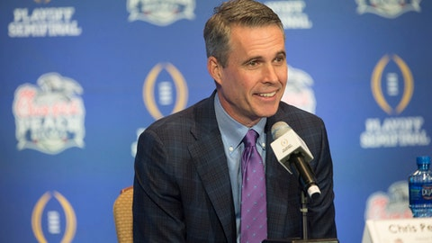 Washington head coach Chris Petersen smiles during the coaches NCAA college football press conference Friday, Dec. 30, 2016, in Atlanta, for the Peach Bowl. Washington takes on Alabama on Saturday. (Albert Cesare/The Montgomery Advertiser via AP)