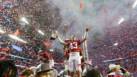 Confetti fills the Georgia Dome as Alabama celebrates a 24-7 victory over Washington in the Peach Bowl NCAA college football playoff semifinal. Saturday, Dec. 31, 2016, in Atlanta. (Curtis Compton/Atlanta Journal-Constitution via AP)