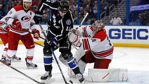 Carolina Hurricanes goalie Cam Ward makes a save against Tampa Bay Lightning's Brian Boyle during the second period of an NHL hockey game Saturday, Dec. 31, 2016, in Tampa, Fla. (AP Photo/Mike Carlson)