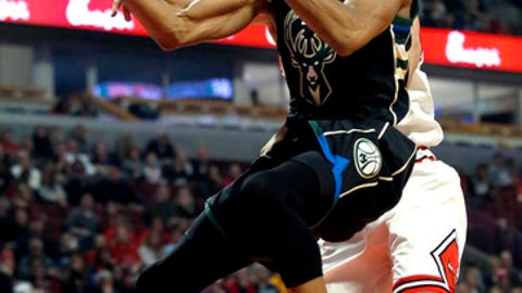 Milwaukee Bucks forward Giannis Antetokounmpo, right, drives to the basket as Chicago Bulls center Robin Lopez guards during the first half of an NBA basketball game Saturday, Dec. 31, 2016, in Chicago. (AP Photo/Nam Y. Huh)