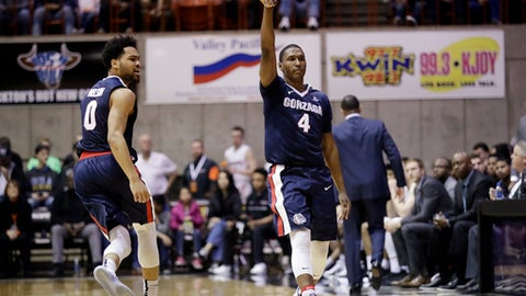 Gonzaga guard Jordan Mathews (4) signals after making a 3-point basket, next to teammate Silas Melson (0) during the second half of an NCAA college basketball game against Pacific on Saturday, Dec. 31, 2016, in Stockton, Calif. Gonzaga won 81-61. (AP Photo/Marcio Jose Sanchez)