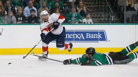 Florida Panthers center Vincent Trocheck (21) gets the puck past Dallas Stars defenseman Dan Hamhuis (2) during the second period of an NHL hockey game in Dallas, Saturday, Dec. 31, 2016. (AP Photo/Michael Ainsworth)