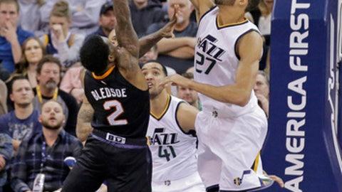 Utah Jazz center Rudy Gobert (27) blocks the shot of Phoenix Suns guard Eric Bledsoe (2) in the second half during an NBA basketball game Saturday, Dec. 31, 2016, in Salt Lake City. Jazz won 91-86. (AP Photo/Rick Bowmer)