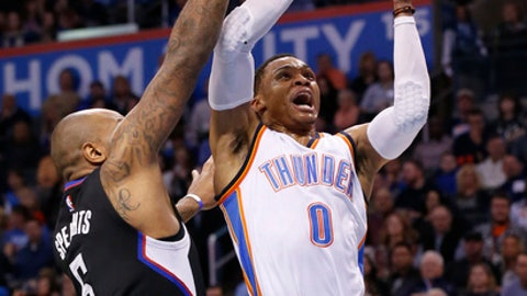 Oklahoma City Thunder guard Russell Westbrook (0) shoots in front of Los Angeles Clippers center Marreese Speights (5) during the first quarter of an NBA basketball game in Oklahoma City, Saturday, Dec. 31, 2016. (AP Photo/Sue Ogrocki)
