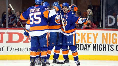 Oct 9, 2015; Brooklyn, NY, USA; New York Islanders center John Tavares (91) celebrates his goal against the Chicago Blackhawks with teammates during the second period at Barclays Center. Mandatory Credit: Brad Penner-USA TODAY Sports