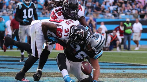 Dec 13, 2015; Charlotte, NC, USA; Carolina Panthers tight end Greg Olsen (88) injures his knee as he misses a reception broken up by Atlanta Falcons free safety Ricardo Allen (37 during the second quarter at Bank of America Stadium. Mandatory Credit: Jim Dedmon-USA TODAY Sports