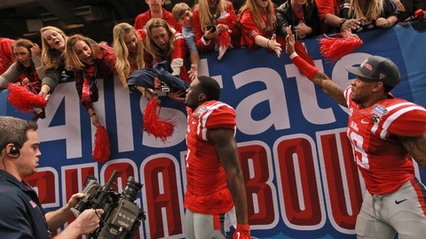 Jan 1, 2016; New Orleans, LA, USA; Mississippi Rebels defensive back Tony Bridges (1) and Mississippi Rebels wide receiver Derrick Jones (19) celebrate with fans after the Rebels defeated Oklahoma State Cowboys 48-20 in the 2016 Sugar Bowl at the Mercedes-Benz Superdome. Mandatory Credit: Crystal LoGiudice-USA TODAY Sports