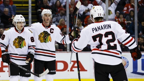 Mar 2, 2016; Detroit, MI, USA; Chicago Blackhawks left wing Artemi Panarin (72) receives congratulations from right wing Patrick Kane (88) and center Jonathan Toews (19) after scoring in the second period against the Detroit Red Wings at Joe Louis Arena. Mandatory Credit: Rick Osentoski-USA TODAY Sports